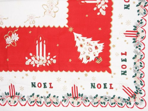 Noels Among the Decorations on Vintage Tablecloth